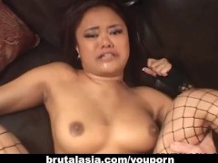 Picture Alluring Asian hottie moans while her ass is...