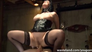 She sucks his cock in leather and chains before cumshot