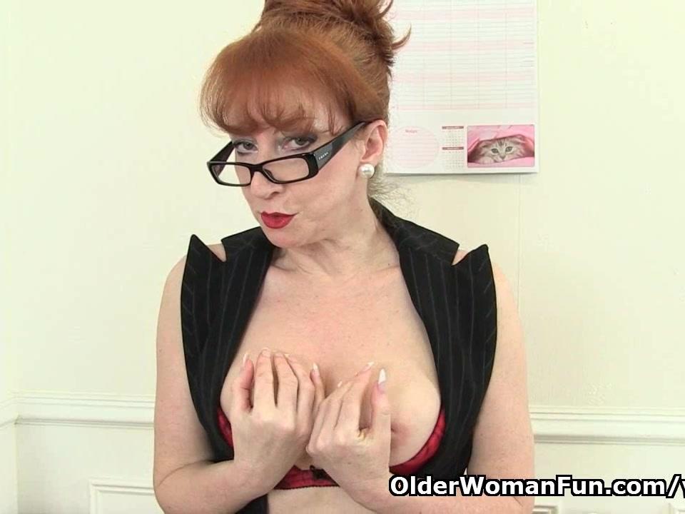 British milf Red works her swe