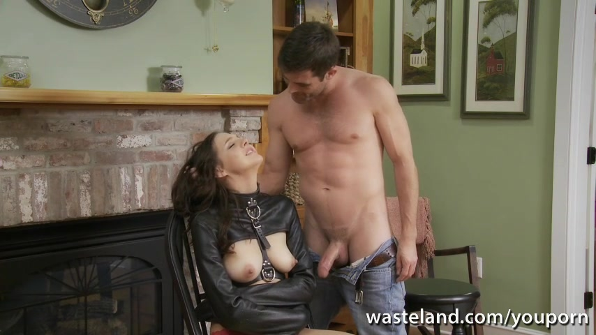 Restrained brunette in leather