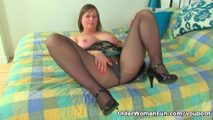 British mom April works her pussy in tights