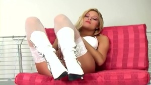 Beautiful blonde masturbates in thigh high nylon