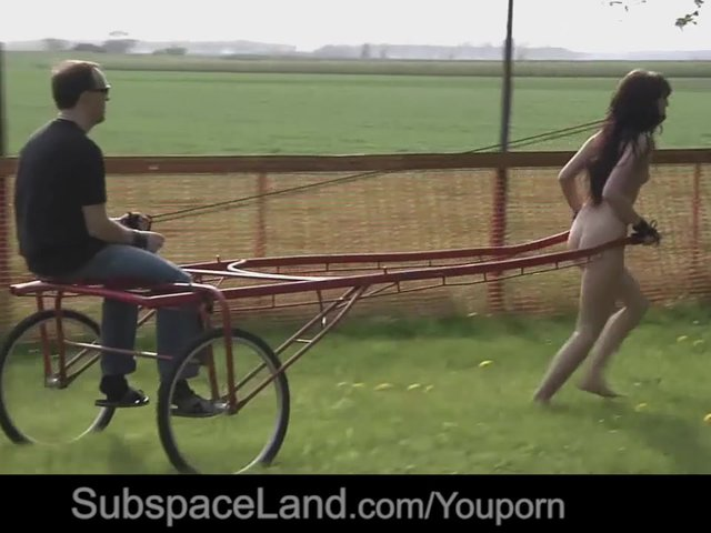 image Slave teen pulling cart while tied and gagged