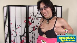 Solo asian shemale in glasses toying herself