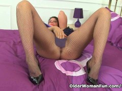 Picture British milf Lulu fondles her big tits and f...