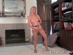 Picture Granny Claire plays with her unshaven pussy