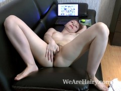 Picture Trixie strips and masturbates on her black c...