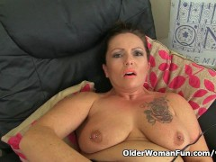 Picture British milf Sam works her clit with a huge...