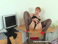 Picture UK milf Red will assist you at the office to...