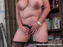 Picture Busty milf Mia Jones loves stripping off for...