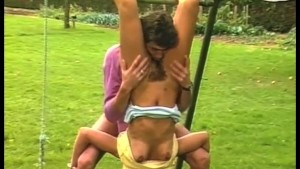 Horny Brunette fucked on a Swing!