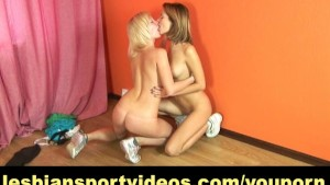 Shy brunette getting undressed by lesbian coach