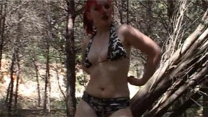 Sabrina strips in the woods