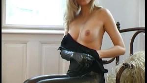 Pornstar Magdi strips in shiny spandex