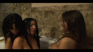 Three hot chicks in a bathtub are joined by one dick