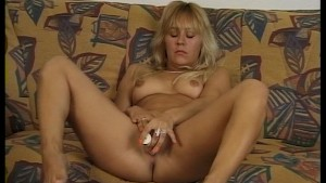 Horny gal preps her pussy with a dildo
