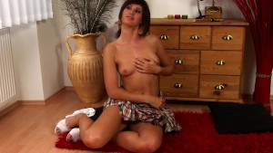 Adorable Kittka plays with dildo solo