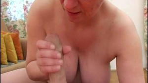 Busty mature broad sucks a fat cock
