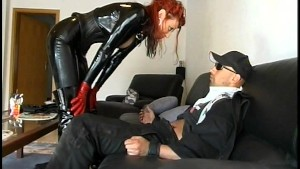 Guy gets seduced by redhead latex girl