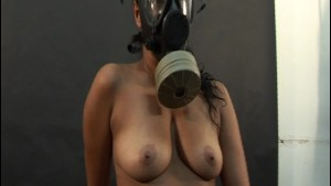 Solo Latina poses in gas mask