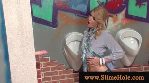 Blond slut blows cock through gloryhole