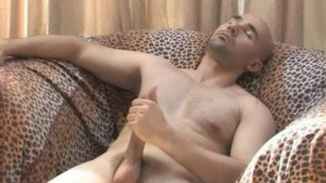 Bald guy jerking off his penis