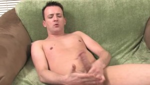 Mature gay jerking off on the green sofa
