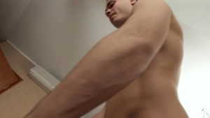 Duke jerking huge cock on the white bed