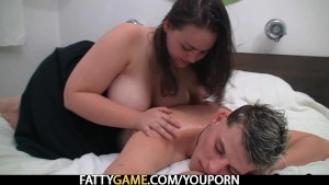 Plump masseuse rides young cock