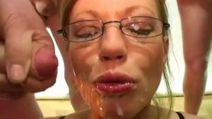 British redhead pornstar Holly Kiss gets spunked in a bukkake party