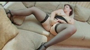 Busty Brunette Plays With Her Clit