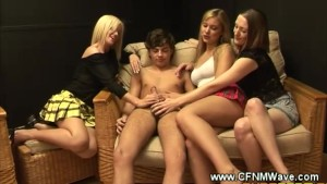 CFNM get a kick out ot stroking guys hard dick on the sofa