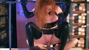 Redhead fucking in gloves and