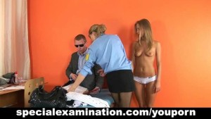 Police doctor examines hot blonde