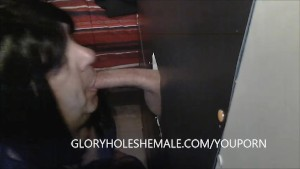 SHEMALE SUCKING BEER CAN COCK AT GLORYHOLE