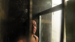 BEAUTIFUL MAN BEHIND BARS IN THE SHOWER