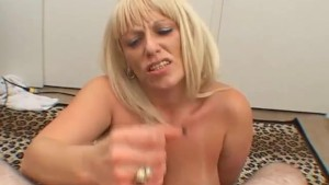 Busty blonde sucking a cock smaller than her tits
