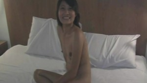 Amateur Asian babe strips and