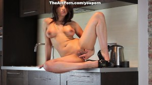 Busty chick Angel Rivas masturbates in the kitchen