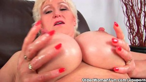 Granny with big tits finger fucks her sweet matured pussy
