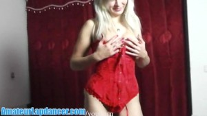 Busty sexbomb lapdances in red lingerie