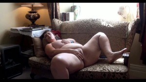 Chubby shaved cunt masturbating in living room