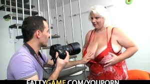 Shooting pics of her huge boobs turns him on