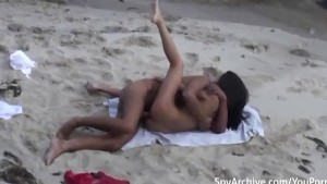 Voyeur video of a couple having sex on the beach