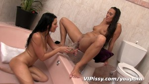 Lesbian lovers share golden showers in pee fill bath