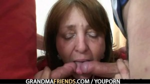 Naughty granny takes two rods