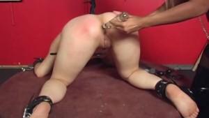 Bound Asian skank on a revolving platform gets stimulated