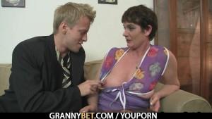 Naughty granny jumps on stiff meat