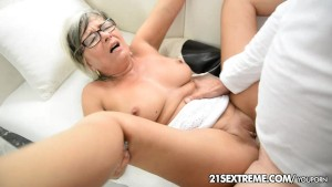 GILF Jessye wrestles with a huge cock