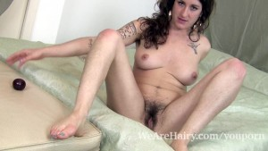Stacey Stax sucks on a plum an